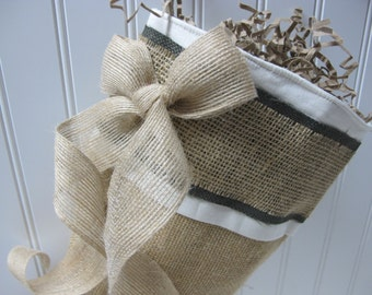 Burlap bow adds charm to the burlap and green stocking
