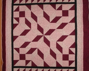 Carpenters Star quilt Queen size in shade of burgundy made by Vivian Ketron