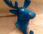 Cast iron moose head wall hook. Dark teal