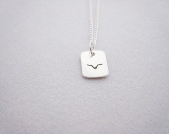 tiny single flying bird necklace, sterling silver, reversible