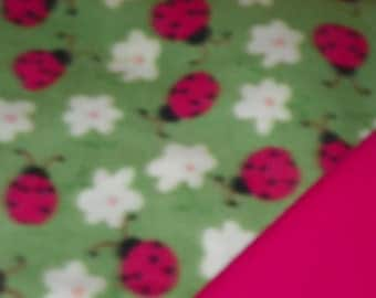 Pink Ladybugs Baby Blanke  with a Hot Pink  Backing . Double Fleece Sewn Together
