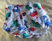 """SassyCloth one size pocket diaper with """"cars going round"""" on white PUL print. Ready to ship."""