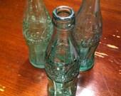 24 Vintage green coke bottles reserved for michelle
