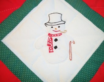 Christmas baby quilt, hand embroidered