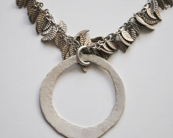 Hammered sterling silver circles and sterling silver chain with silver plated leaves