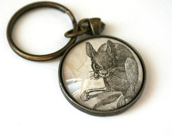 Steampunk accessory. Recycled, upcycled, repurposed art. Goth art gift.Vintage animal art.  Vintage keychain. Creepy cute mouse art jewelry.
