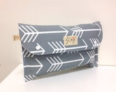 Diaper clutch nappy wallet bag. 'White Arrows' on grey cotton. Fantastic baby shower gift.