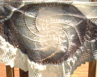 Swirled crescent hand knit lace shawl in black, white, and grey
