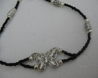 Butterfly and glass beads bracelet.