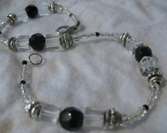 Black and clear crystal anklet.