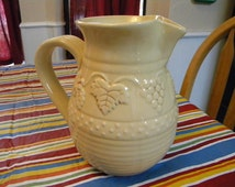 Della Robbia pitcher in cream pottery midcentury vintage