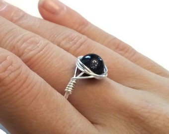 8mm Blue Goldstone wire wrapped ring silver tone