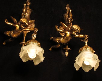 Pair of Wall lights sconces with angel cherub sculptures solid bronze by Sergio Merlin