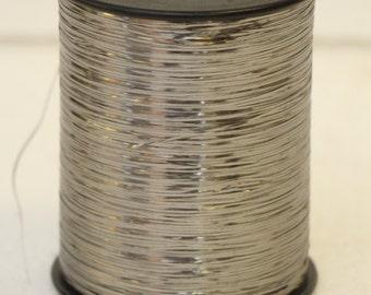 Spool of Sliver acetate thread