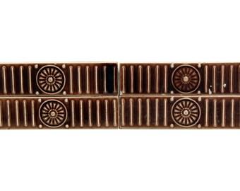 Burgundy ceramic burst accent tile