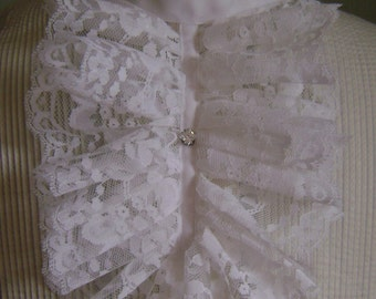 Ruffled lace jabot with stick pin