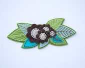 Embroidered felt brooch with flowers and leaves