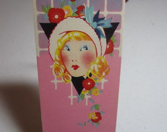 1920's-30's unused  art deco colorful bridge tally card with pretty lady wearing a cloche hat surrounded by deco flowers on a lattice