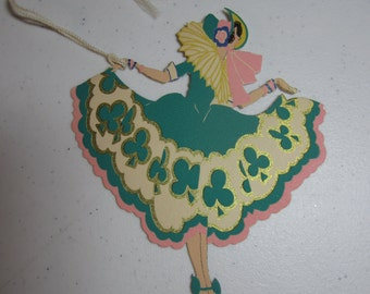 Art Deco unused 1920's-30's die cut gold gilded Gibson St. Patrick's Day bridge tally flapper dressed in dress with green clover designs