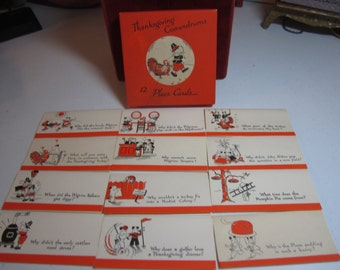 1930's unused art deco Norcross boxed set of 12 thanksgiving conundrums place cards unique graphics of terrier dogs as pilgrims