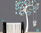 Turquoise and cerulean wall decal designed tree with birds, owls and koalas