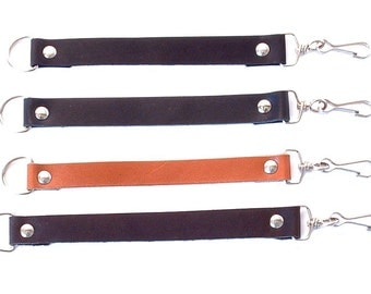 Leather wristband with carabiner and D ring