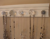 "White necklace rack. This jewelry organizer wall hanging features 5 clear glass or acrylic decorative knobs total /15 "" jewelry storage"