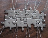 Eight Initial Stamped Silver Pendant Necklaces