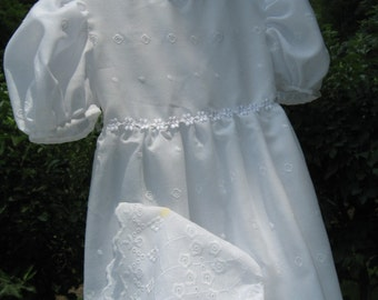 White Christening dress and bonnet in eyelet lace.
