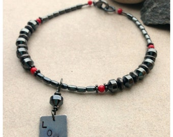 Manly Hematite Stones Mix with Gunmetal Components with Coral accents and a Gunmetal Hand Stamped LOVE Charm
