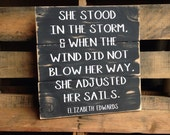 She Stood In The Storm and When the Wind Did Not Blow Her Way She Adjusted Her Sails - Elizabeth Edwards - Handmade Decorative Wood Sign