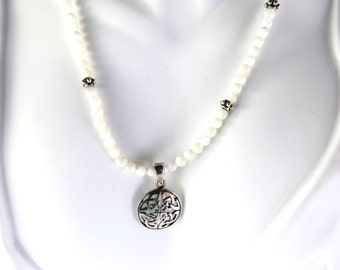 White beaded necklace with celtic knot