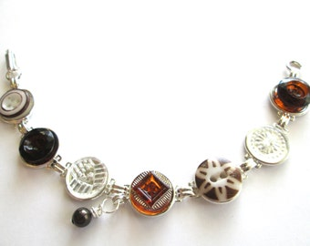 Antique button bracelet. Lovely browns, ambers. 1800s buttons, silver links