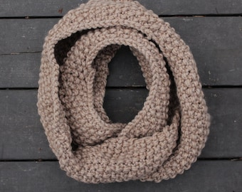 The Cape North Scarf - seed stitch chunky hand knit infinity scarf in warm sand color