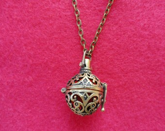 Antique Brass Aromatherapy locket on black leather cord or chain + Essential Oil sample of your choice