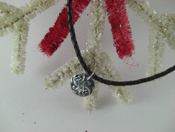 Silver Pendant on braided leather