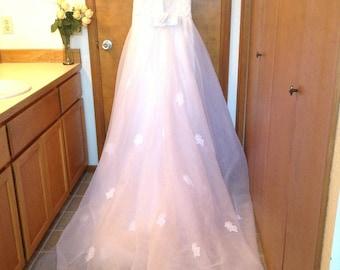 Beautiful beaded wedding dress with train.