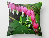 Valentine. Vivid pink bleeding hearts flower on green leaves photo pillow cover