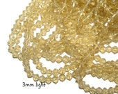 Bicones Glass - 3 mm - light brown/topaz 100 beads (075)