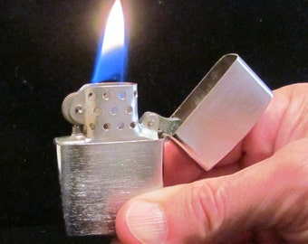 1950s Windproof Lighter Pocket or Purse Lighter Cigarette Lighter Brushed Silver Tone Flip Type Japan Unused Excellent Working Condition