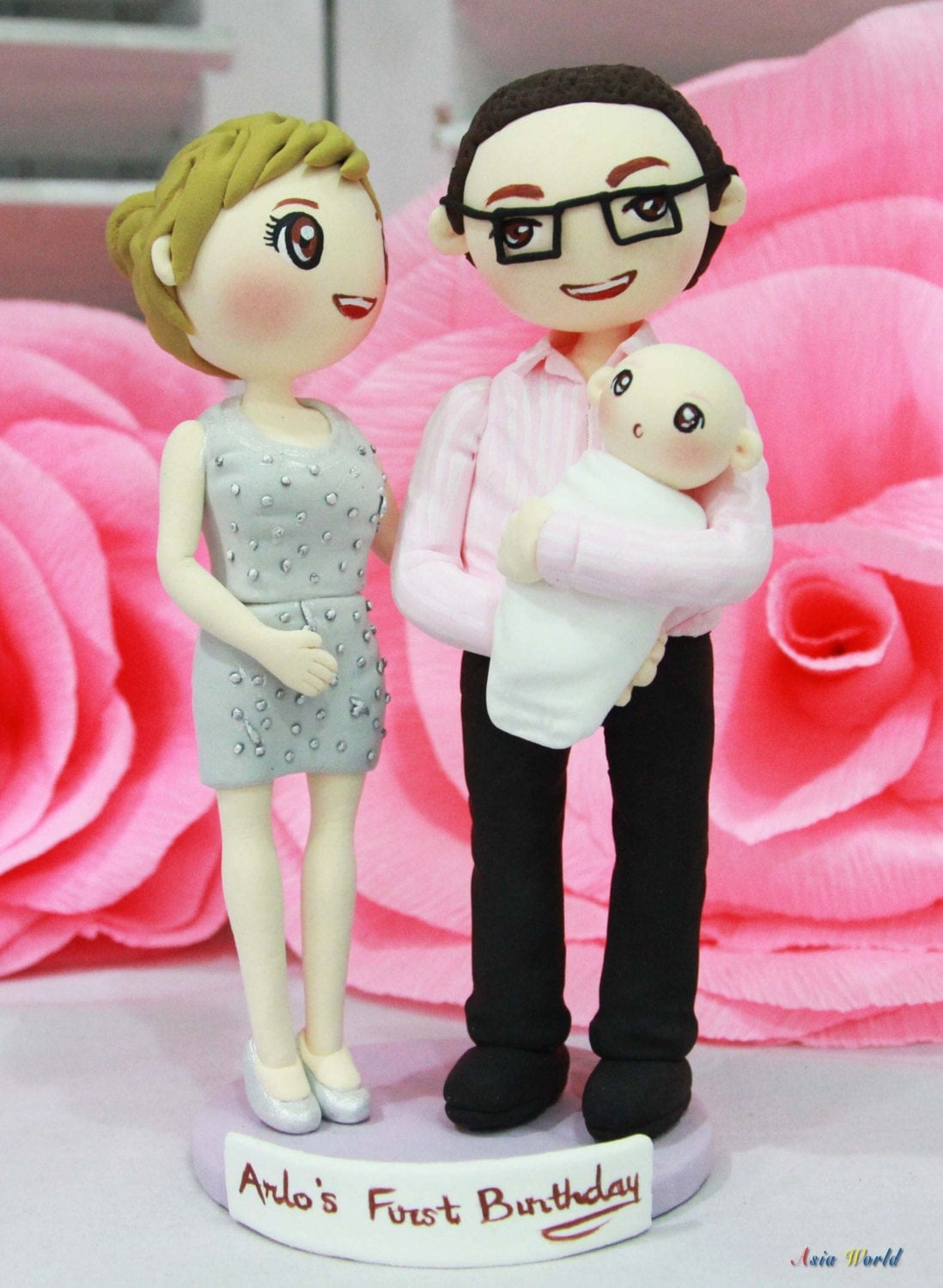 Wedding cake topper couple with their baby baby shower clay