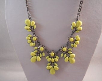 Bib Necklace with a Dull Silver/Grey Chain and Yellow and Rhinestone Pendants.