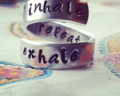 Inhale exhale repeat spiral ring
