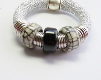 Bracelet cord with loops.