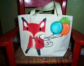 Mr. Fox is a hand painted canvas tote, perfect for holding your day trip goods
