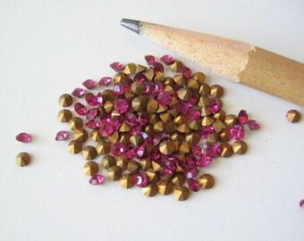 50 Swarovski fuchsia pink crystal rhinestone chatons with gold foil. SS7  2.1-2.3mm
