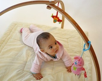 Mahogany veneer coated baby gym. Wooden baby gym for hanging toys and mobiles. Folding play gym.