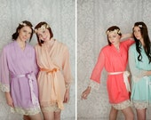 4 custom lace trimmed chiffon robes in a knee length. Bridesmaids robes and bridal robes in soft pastels.