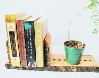 Unique, adjustable split log bookends. Rustic decor book stand.