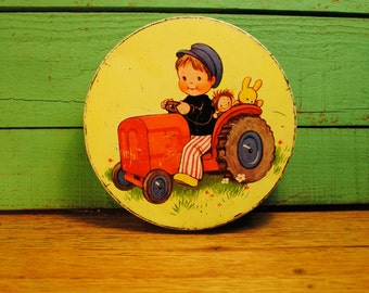 charming childrens Mable Lucy Attwell English Iced Biscuit Cookies candy tin Boy with Red Tractor and toys 1930s antique candy tin green red